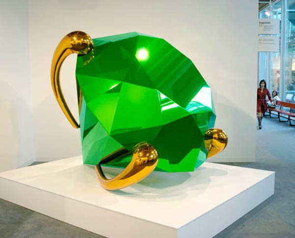Giant green diamon-shaped sculpture by Jeff Koons