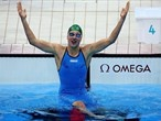 Ruta Meilutyte of Lithuania celebrates after winning the final of the women's 100m Breaststroke