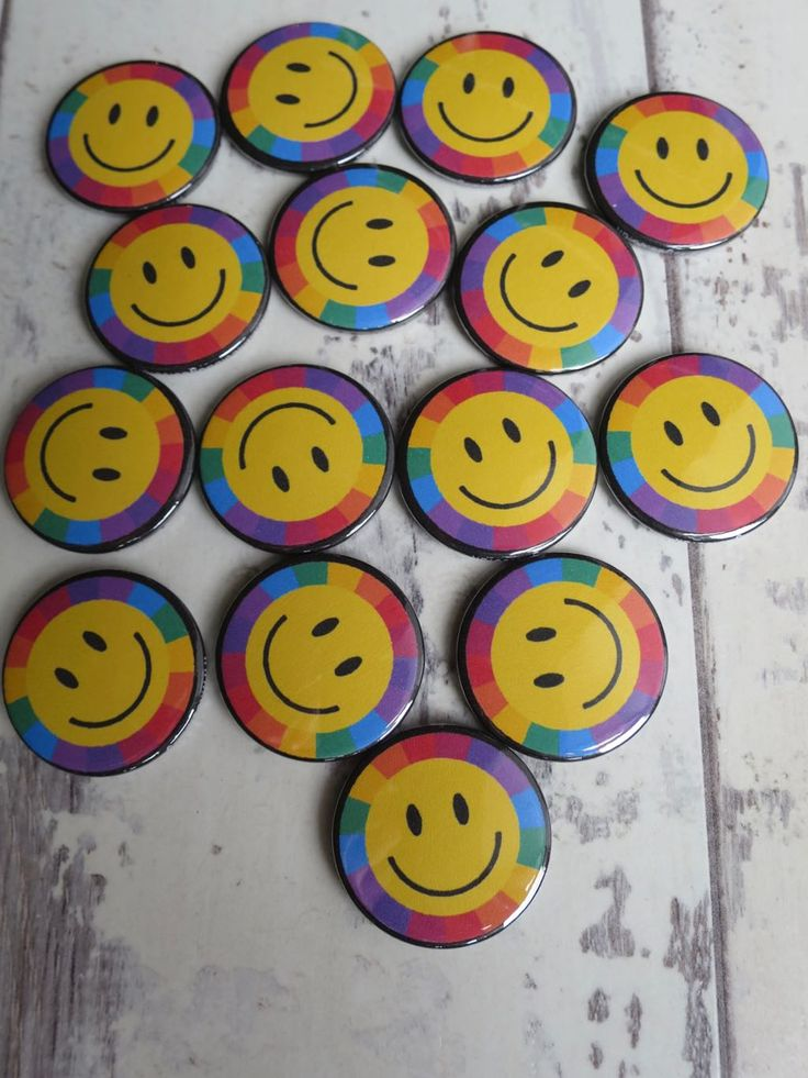 Trippy  smiley face badges.  We make all of our badges by hand in our small Corn… – Button badges