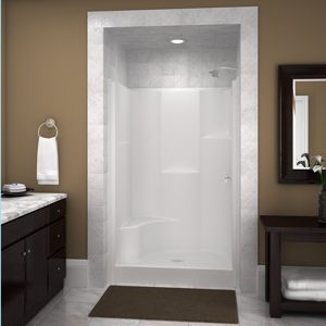 We're switching to a fiberglass shower stall kit because we've had it with leaking tile jobs. Love how this photo dresses this ready-kit up by framing it in and adding tiles at the top!!
