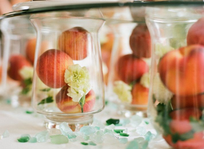 Peach centerpiece - what a unique and cute idea!  Very pretty intermingled with real flower centerpieces and cuts cost