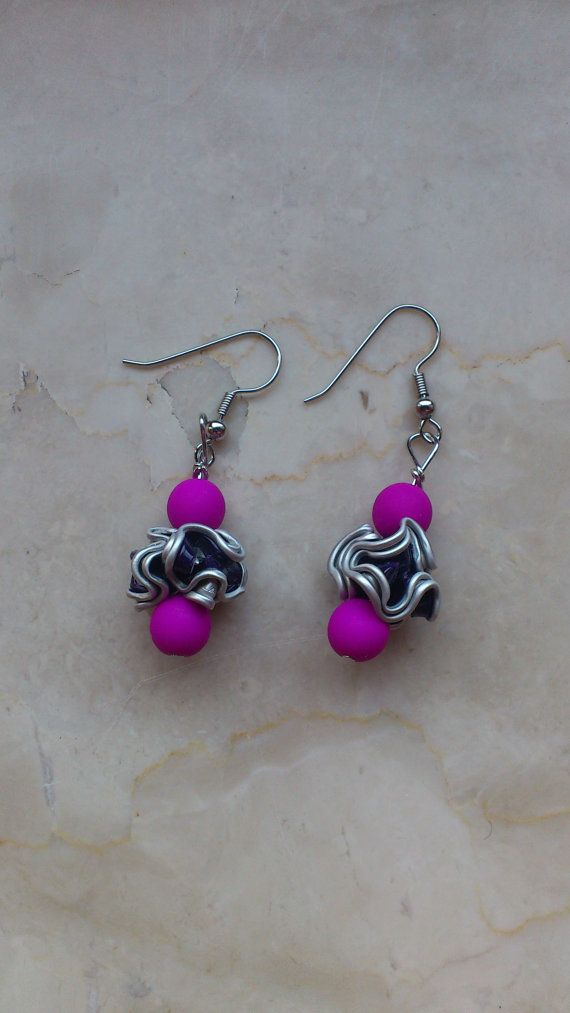 earrings made with recycled Nespresso capsules