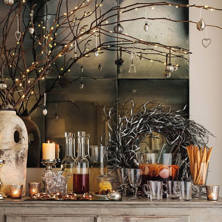 Branches - simple and inexpensive, just add fairy lights and a few minimalistic ornaments and  voila