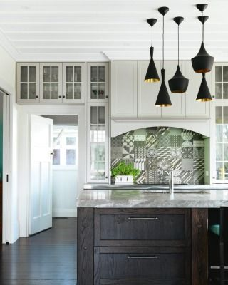 HIGHLY COMMENDED HELEN WILCOCK OF DESIGN.SPEC AND ANITA MAES OF BELLA CASSITA: The challenge was to create a kitchen that works for a family of today, yet still stays true to the design of this heritage Auckland home. The hob splashback is a standout feature, combining 27 different tile patterns in colours of black, white and grey.