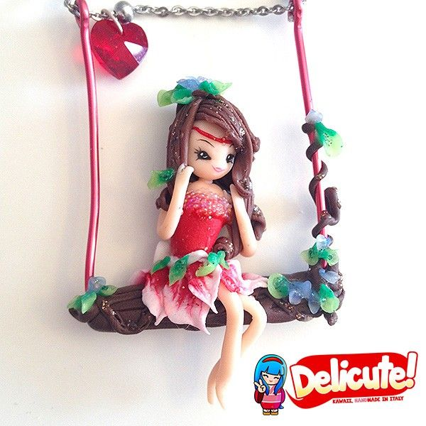 Swingaloos are lovely fairies on a swing, dangling on the chain of the necklace. These jewels are completely handmade, 100% Made in Italy.  Find it on www.Delicute.com