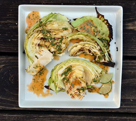 [ Recipe: Grilled Cabbage Wedges with Spicy Lime Dressing ] Made with: limes, extra-virgin olive oil, fish sauce, garlic cloves, salt, cayenne, sugar, lime wedges, green cabbage, and grapeseed (or canola oil). ~ from The Kitchn