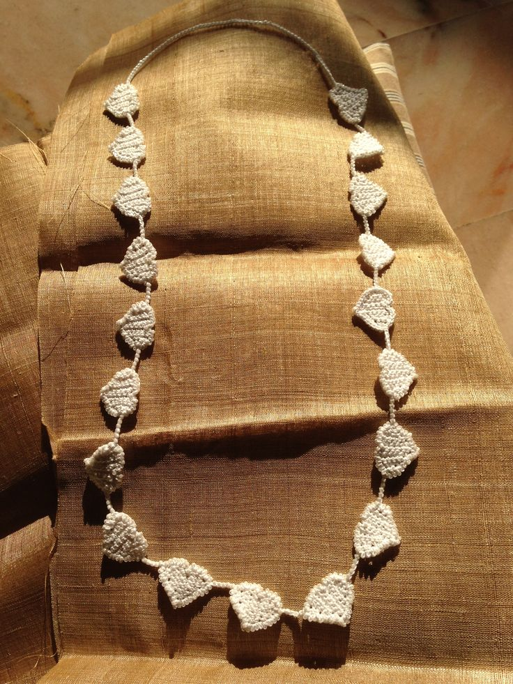 handmade crochet hearts necklace over wild ahimsa natural gold silk ground