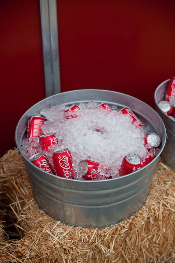 Sodas on ice on a large tin container-great for outdoor BBQ's and Parties / http://www.deerpearlflowers.com/rustic-buckets-tubs-wedding-ideas/
