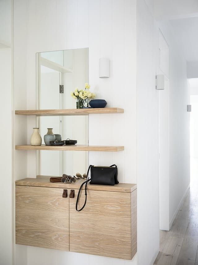 Sure, it's easy to make a functioning entryway if your home has a space specifically dedicated to the art of entering, and if that space is enormous. But if you're living in an apartment or a house with a tiny entry foyer, or none at all, finding a space to stash your coats and shoes and keys and bags can be quite a bit more challenging. Challenging, but not impossible. Here are five strategies for eking an entryway (or entry spot) out of almost no space at all.