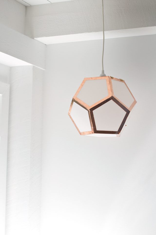 Learn how to make a dodecahedron light from a few basic supplies. With a little time, you can have your own geometric pendant light.