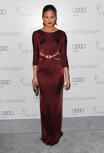 Chrissy Teigen Cutout Dress - Chrissy wore the most elegant of cutout dresses at the Art of Elysium Heaven Gala in this burgundy jeweled number.