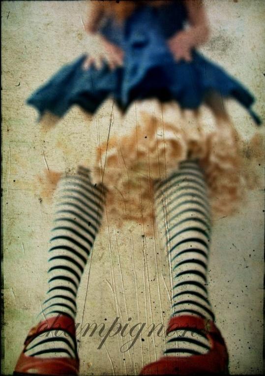 Striped tights, a bit Alice-in-Wonderland-bizarre, quirky-cute.