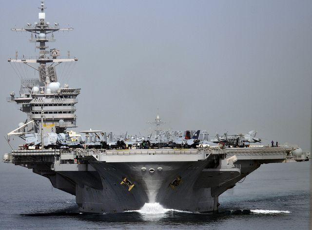 The aircraft carrier USS Carl Vinson (CVN 70) transits the Strait of Hormuz