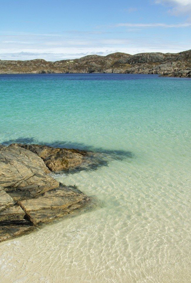 This crystal clear water is Achmelvich, in Wester Ross on the west coast of Scotland.