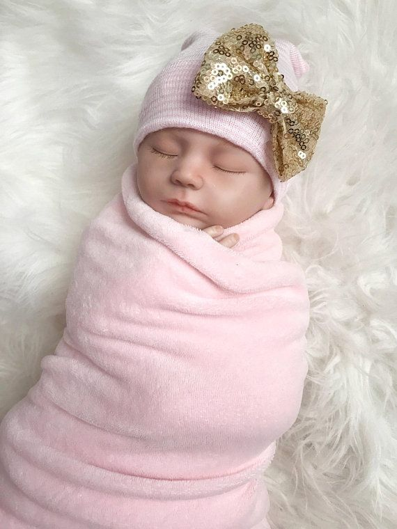 851c09e9a4f7 This newborn hospital hat for girls is so sweet! She will be the star in  the nursery! Stretch nylon hat is adorned with a sparkly bow in your color  choice.
