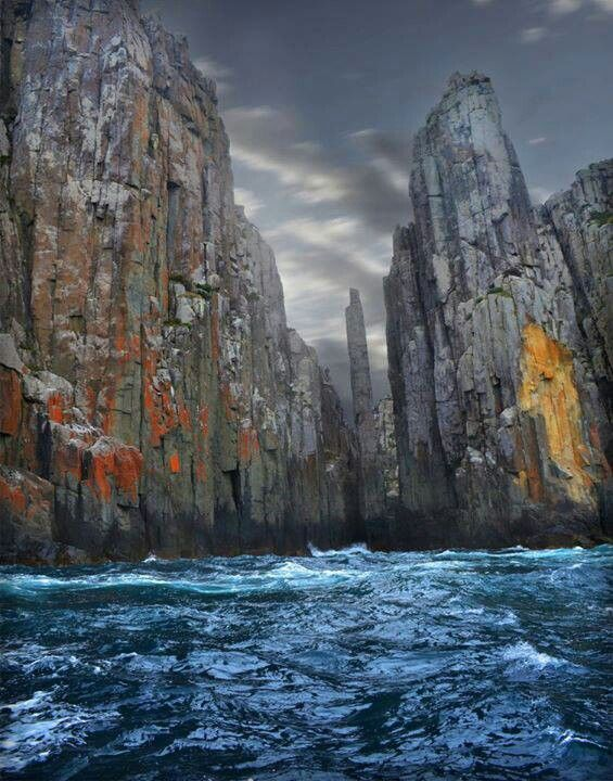 Tasmania. Take a boat ride to see these dolermite cliffs.