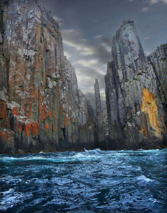 Tasmania. Enjoy a fantastic boat ride to see these spectacular dolermite cliffs.