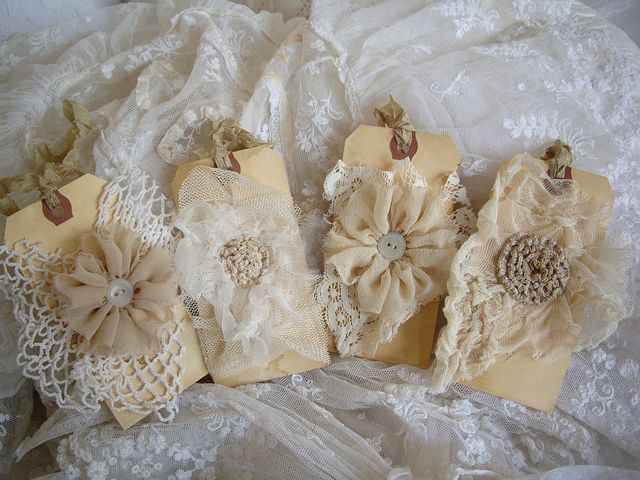 Vintage gift tags ~ more reasons to make fabric flowers,,hmmmmm what could we do with these?