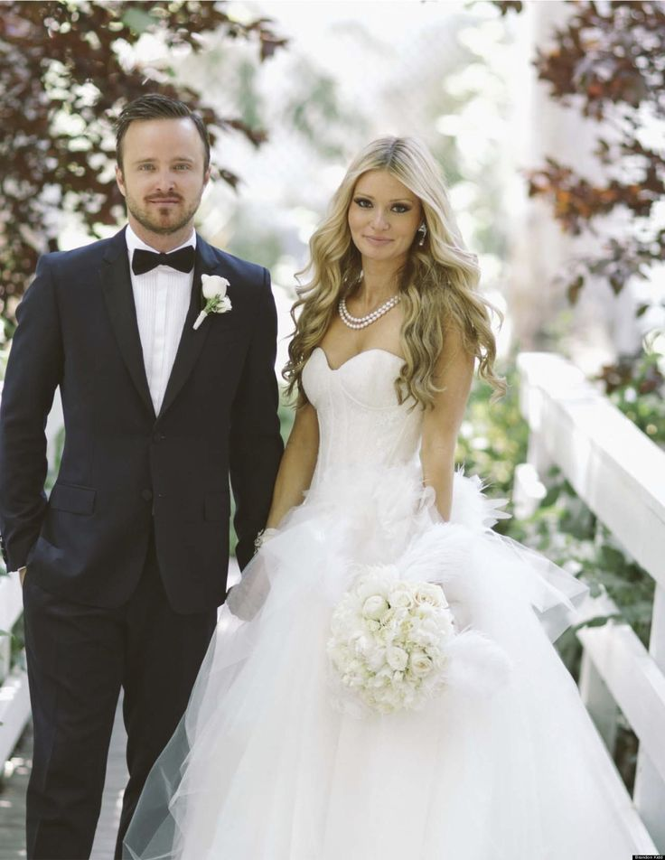 Aaron Paul tied the knot with activist Lauren Parsekian Sunday in a Paris-themed wedding at Cottage Pavilion at Calamigos Ranch in Malibu, Calif. Parsekian wore the Paris gown by Kenneth Pool and white boots, and her bridesmaids donned vanilla chiffon Amsale gowns.