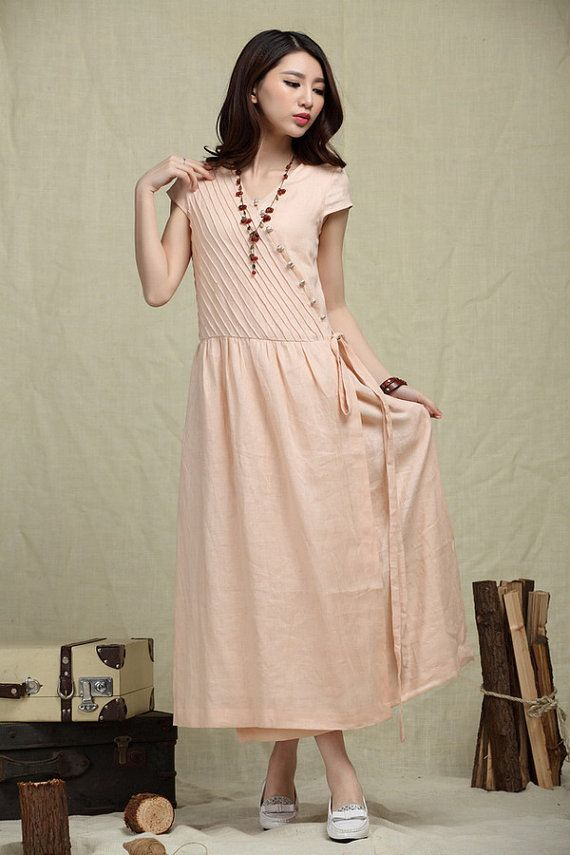 luxurious pleated long linen dress for women.  Design: Single breasted with wood buttons; Stereo striped pleats all the top part, elegant and