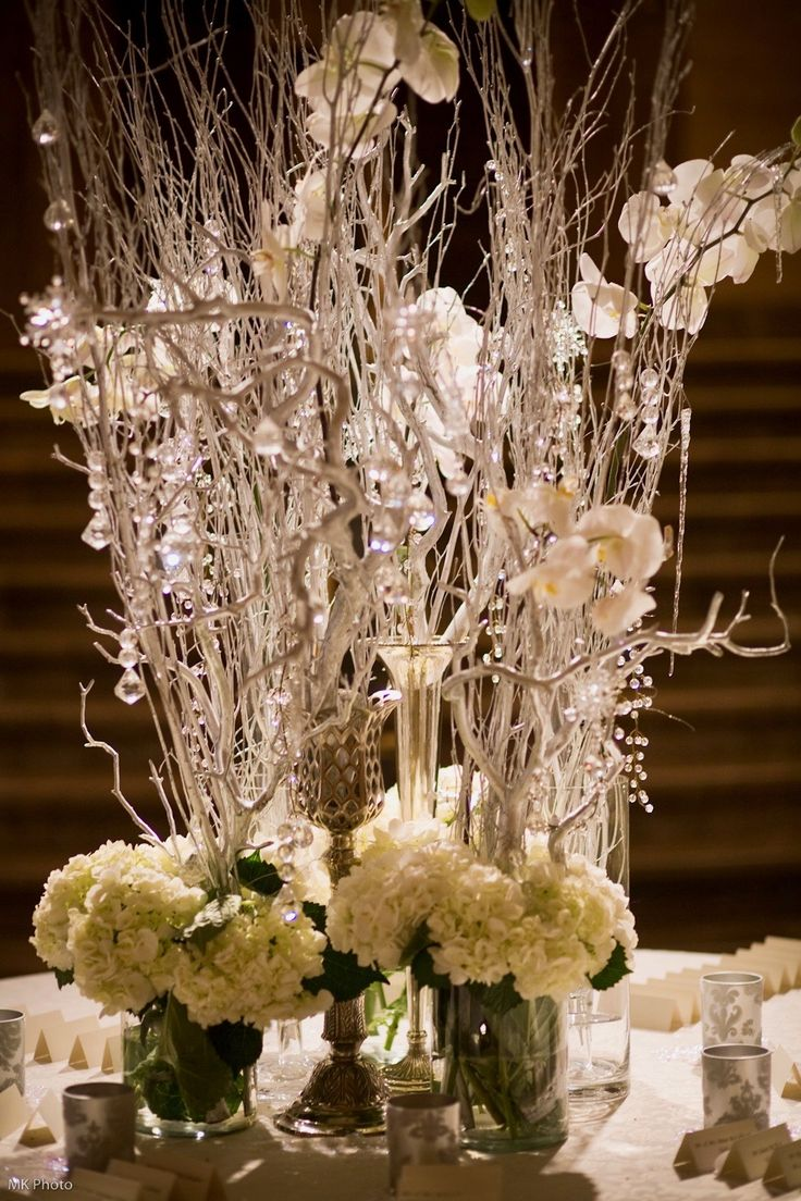 Winter white flowers, branches and crystals greet guests at the Hotel DuPont for Allison and Ethan's reception. MK Photography.