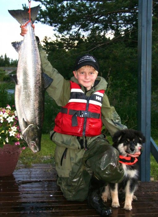 Happy young salmon fisher in Pello in Lapland, Finland