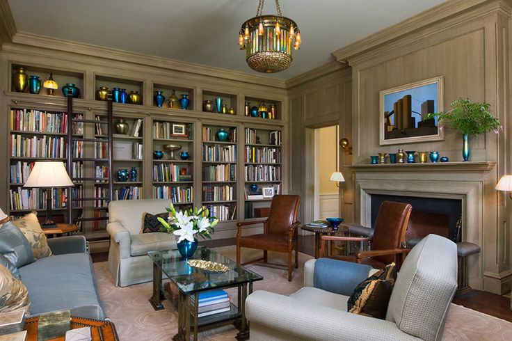 Transitional living room and library designed by @Curtis & Windham Architects, Inc.