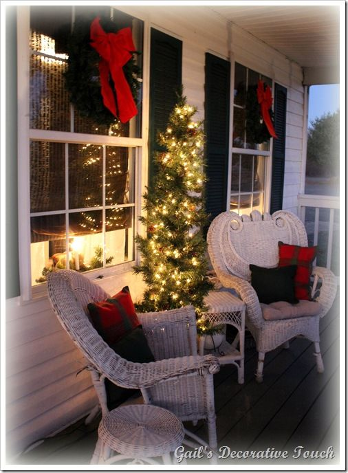 Holiday Front Porch, I had to look at this close, looks like my front porch except for the green shutters!  I had the same wreaths, lit trees, chairs, and tables.