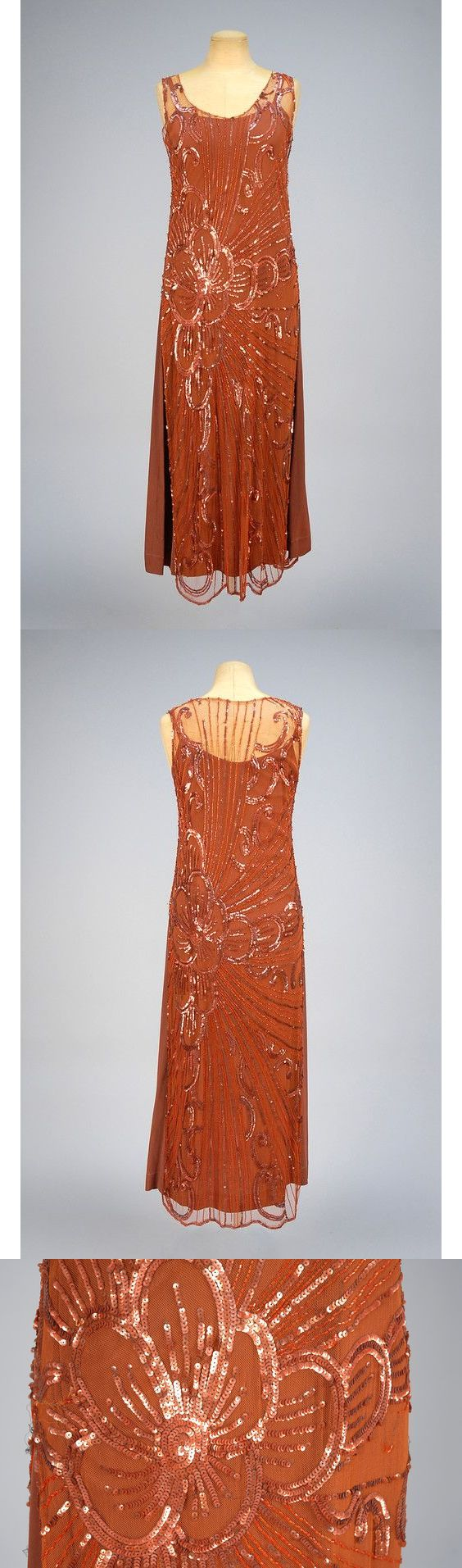 SEQUINED NET TABARD, 1920s. Bronze tulle decorated with an off-center floral burst in copper sequins and burnt orange beads. Together with a brown silk under-dress. B-36, L-51. $510