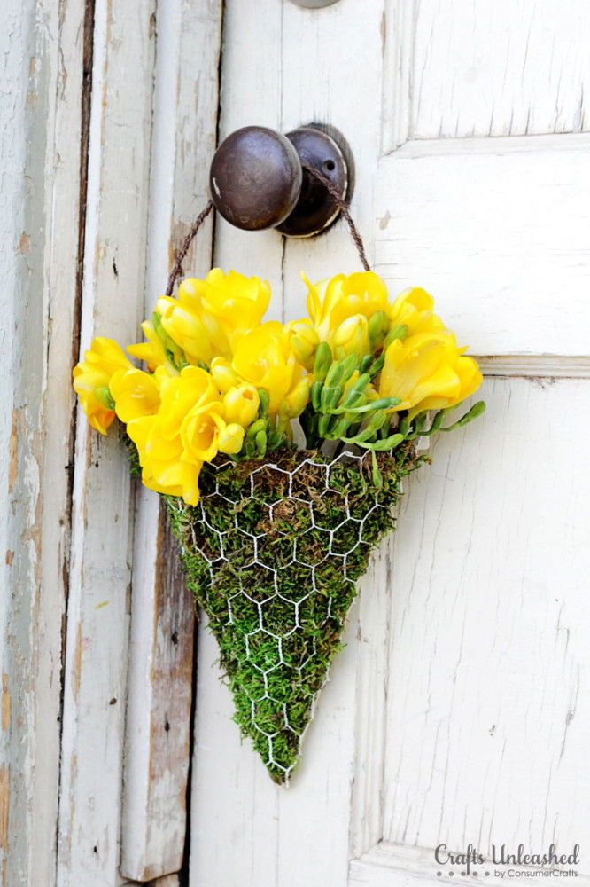 Chicken Wire and Moss May Day Basket — Vanessa from Crafts Unleashed made floral wall sconces using chicken wire and moss. The yellow freesias look amazing in this rustic May Day basket.