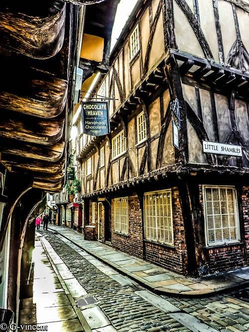 A glimpse of 'The Shambles', a district of medieval streets in viking York, England, UK.