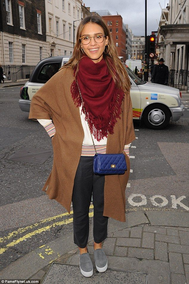 Cute: Jessica Alba rocked a geek chic look as she stepped out in London on Wednesday...