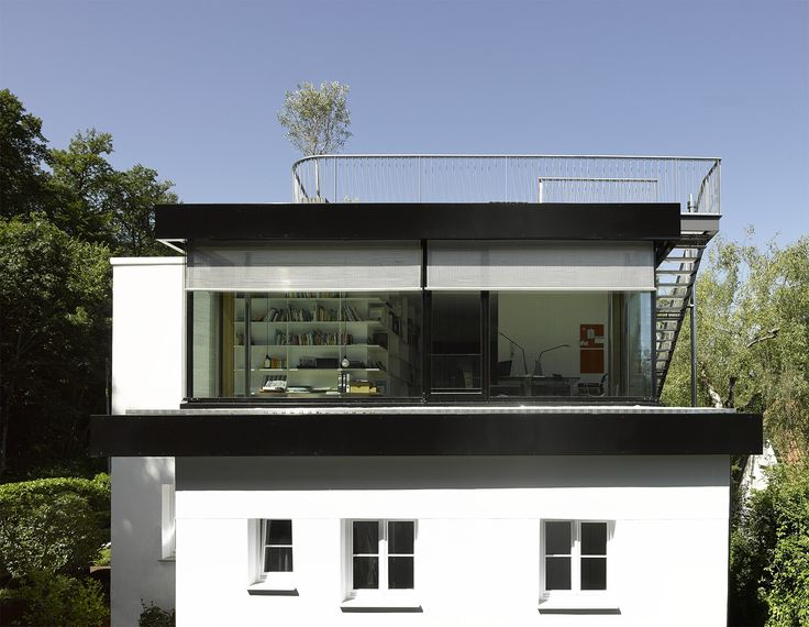 This private residence was revisioned to embrace the surrounding woods and tranquil hillside location while also offering city views of Stuttgart from a new upper floor. In place of a double-pitched roof, a simple yet structured, open-plan floor is re