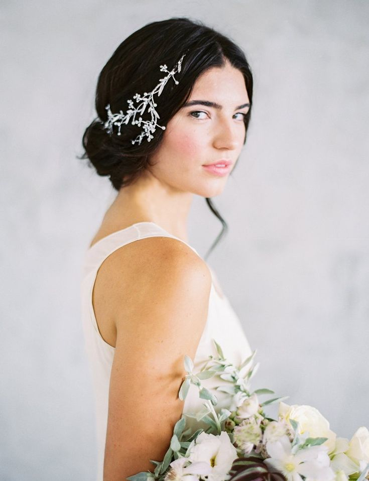 - Beautiful hair vine hand wired with crystals and pearls - This asymmetrical headpiece can be worn as a headband with ribbons or on the back of the head for a half up-do - Finished with 3 loops at th