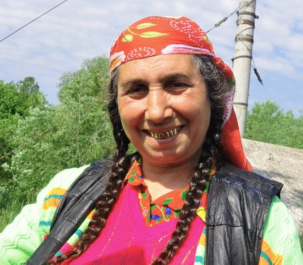 Gypsy woman with her golden smile - Romania