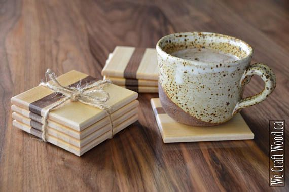 Wooden coaster set made from  walnut and locally sourced Canadian birch. Handmade in Nova Scotia.