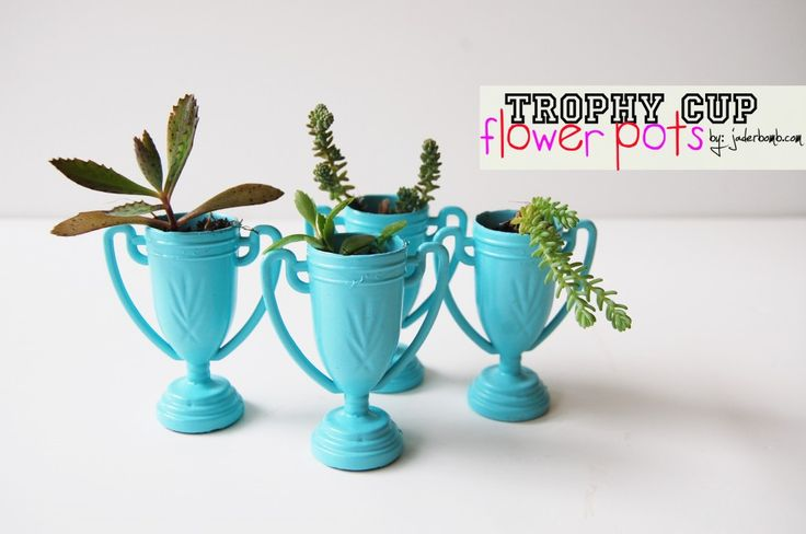 Trophy Cup Flower Pots; simple, cheap, adorable.  I'd like to do this with the kids and deliver them to friends.
