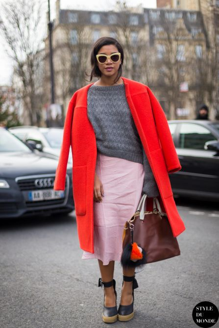 Fashion risks to try in 2015 - pairing bright red and pale pink. // DJ Hannah Bronfman wearing a red winter overcoat, oversized gray sweater + pastel pink pencil skirt. Chic!