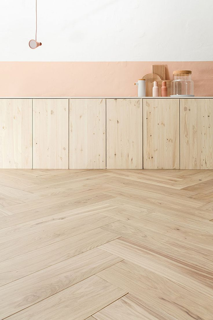 16 Inspirational Pictures Of Herringbone Floors // This light wood flooring matches the cupboards perfectly.