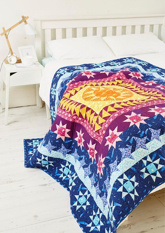 This medallion quilt pattern features Felice Reginas debut fabric line, Luna Sol, for Windham Fabrics. This stunner features striking, but simple borders that are beginner-friendly. A foundation paper pieced center makes a great bite-sized intro to the technique as well as curved piecing.