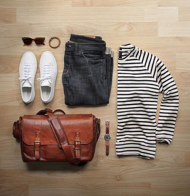 Making sailor stripes a spring staple.  Sweater: @humanscales Carlos Navy Shoes: @commonprojects Watch: @hamiltonwatch Khaki Field Auto Denim: @shockoe_atelier  Bag: @onabags Glasses: @rayban