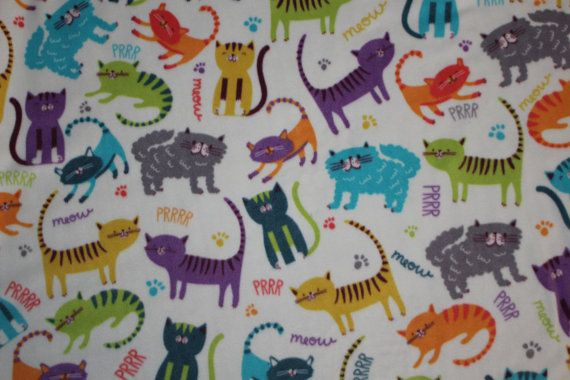 So soft & snuggly kitty cats fleece blanket! (4 second side colors to choose)  There is a quilt batting middle liner  Size is 26 x 32