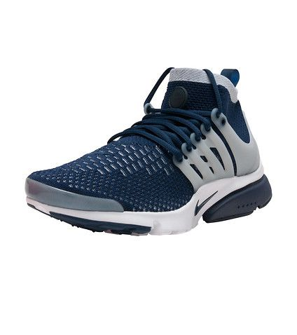 NIKE Mid top sneaker Flyknit upper conforms to your foot for lightweight support Signature TPU cage delivers midfoot support Sockliner and outsole cut-outs enhance breathability and flexibility Mid-cut collar delivers a snug, supportive fit