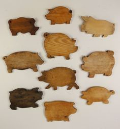 Pig shaped cutting boards ~ My dad made one of these in shop class.