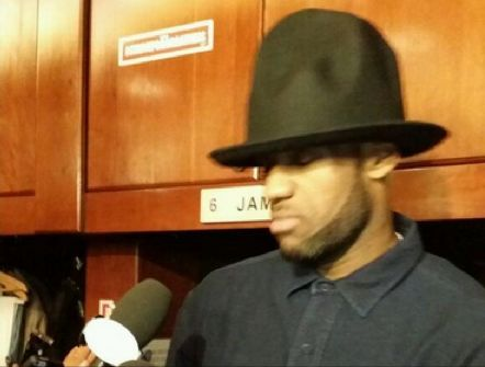 LeBron James wears Pharrell  Williams' 'Happy' hat to address the media following the Miami Heat's loss on Friday.