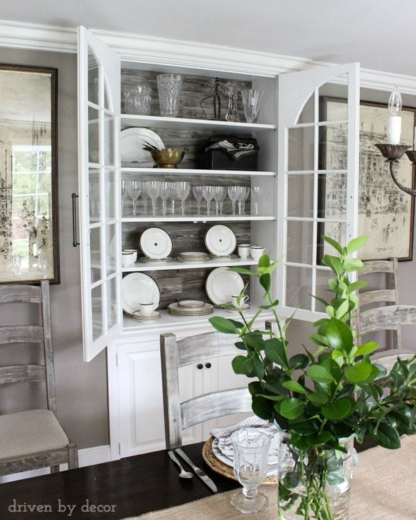 Built In Dining Room China Cabinet With Wood Backdrop And Large Pulls Diningroom