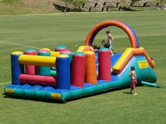 Gladiator Obstacle - This popular interactive inflatable is ideal for the adventurous ones and is also great for team building. It consists of a slide with a combat net at the back of the slide, you climb up the back of the combat net and slide down the slide, then you clumber over and under inflatable obstacles on an inflatable bed. NOT to be used with water. Suitable for kids and adults.