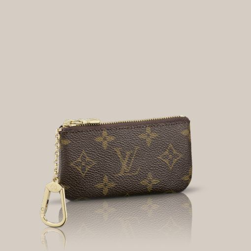 Key Pouch Monogram Canvas This practical pouch holds change and keys and slips easily into a bag or pocket.