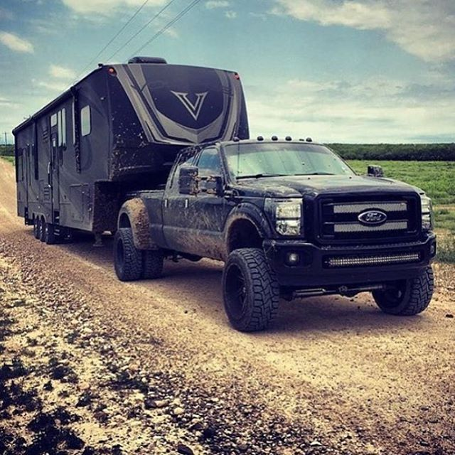 Lifted black blacked out Ford F-250 f350 power stroke diesel pulling, towing, fifth wheel camper, RV, toy hauler, off-road, mud