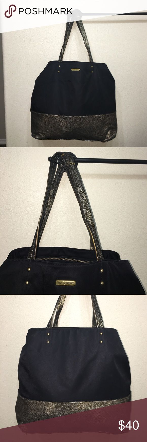 Auth Rebecca Minkoff black & gold tote bag purse Authentic Rebecca Minkoff black & gold nylon tote bag purse Measures 14.5 inches tall. 15 inches long 6.75 inches wide good condition some light scuffs and some of the gold has faded off bottom of tote. Handles show slight wear sold as is Rebecca Minkoff Bags Totes